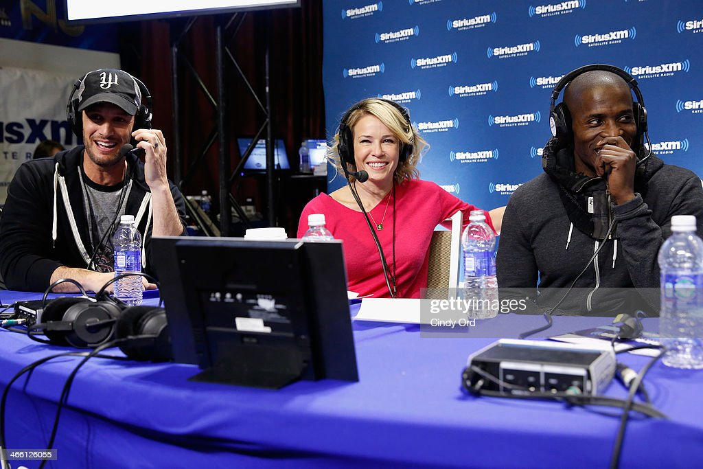 Comedian Chelsea Handler (C) hosts a live SiriusXM show with special guests Josh Wolf (L) and Godfrey (R) at Super Bowl XLVIII Radio Row on January 31, 2014 in New York City.