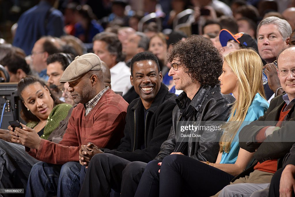 Comedian, Chris Rock and radio personality, Howard Stern watch the New York Knicks take on the Memphis Grizzlies on March 27, 2013 at Madison Square Garden in New York City.