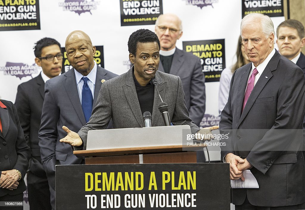 Comedian Chris Rock(C) delivers brief remarks during a press conference February 6, 2013 on Capitol Hill in Washington, DC. Mayors Against Illegal Guns and the Law Center to Prevent Gun Violence held a news conference to call on Congress to act on US President Barack Obama's plan to reduce gun violence, including background checks for all gun sales and an assault weapons ban. AFP PHOTO/Paul J. Richards