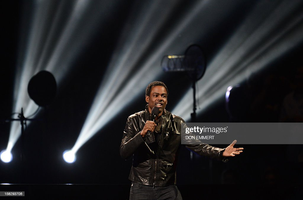 Comedian Chris Rock performs during '12-12-12 The Concert For Sandy Relief' December 12, 2012 at Madison Square Garden in New York. AFP PHOTO/DON EMMERT