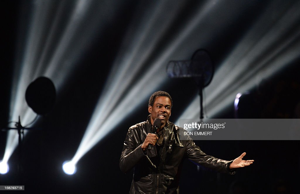 Comedian Chris Rock performs during '12-12-12 The Concert For Sandy Relief' December 12, 2012 at Madison Square Garden in New York.