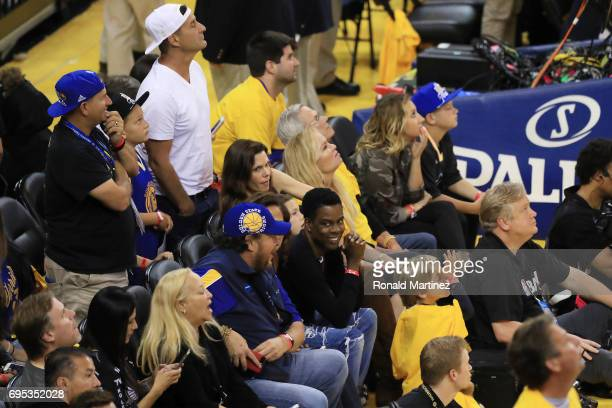 Comedian Chris Rock watches the game during the first half in Game 5 of the 2017 NBA Finals between the Golden State Warriors and the Cleveland...