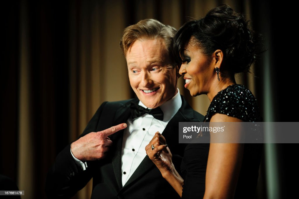 Comedian Conan O'Brien and first lady Michelle Obama pose for the cameras during the White House Correspondents' Association Dinner on April 27, 2013 in Washington, DC. The dinner is an annual event attended by journalists, politicians and celebrities.