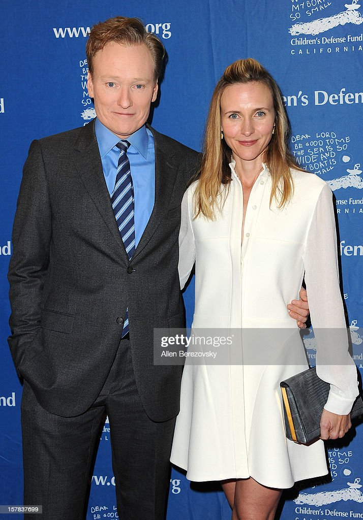 Comedian Conan O'Brien and wife Liza O'Brien arrive at the Children's Defense Fund of California 22nd Annual Beat The Odds Awards at Beverly Hills Hotel on December 6, 2012 in Beverly Hills, California.