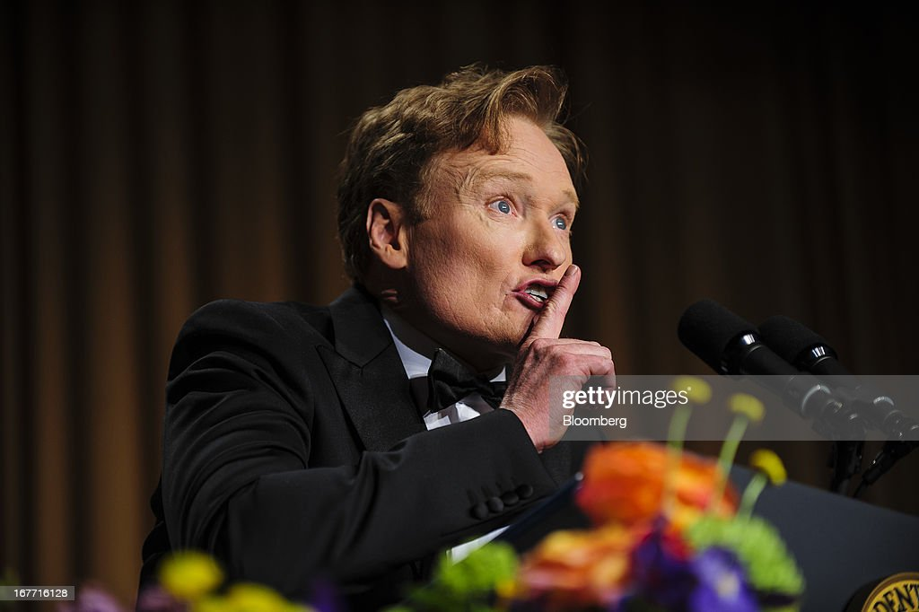 Comedian Conan O'Brien delivers a comedy routine during the White House Correspondents' Association (WHCA) dinner in Washington, District of Columbia, U.S., on Saturday, April 27, 2013. The 99th annual dinner raises money for WHCA scholarships and honors the recipients of the organization's journalism awards. Photographer: Pete Marovich/Bloomberg via Getty Images