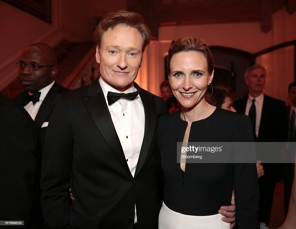 Comedian Conan O'Brien, left, and guest attend the Bloomberg Vanity Fair White House Correspondents' Association (WHCA) dinner afterparty in Washington, D.C., U.S., on Saturday, April 27, 2013. The 99th annual dinner raises money for WHCA scholarships and honors the recipients of the organization's journalism awards. Photographer: Andrew Harrer/Bloomberg via Getty Images
