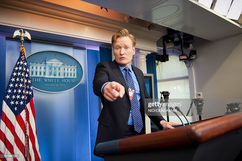 Comedian Conan O'Brien poses at the podium in the White House briefing room in Washington on April 26, 2013. O'Brien will perform at the White House Correspondents' Association dinner on April 27. AFP PHOTO/Nicholas KAMM