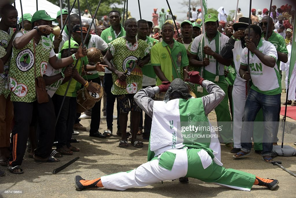 A comedian dances on March 24, 2015 during a rally to mobilize support for the re-election of Nigerian President Goodluck Jonathan and candidate of the ruling Peoples Democratic Party (PDP) in Akure, Ondo State in southwestern Nigeria. Africa's most populous country and top economy, Nigeria, holds general elections on March 28 -- the fifth since civilian rule was restored in 1999.