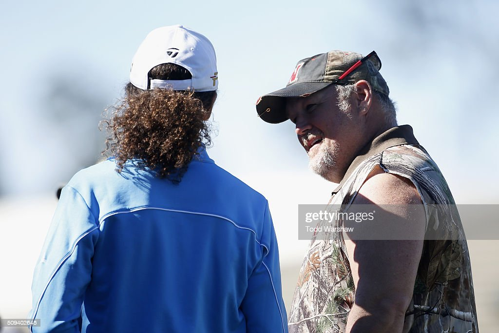 Comedian Daniel Lawrence Whitney (R), also known as 'Larry the Cable Guy', talks to musician <a gi-track='captionPersonalityLinkClicked' href=/galleries/search?phrase=Kenny+G&family=editorial&specificpeople=211357 ng-click='$event.stopPropagation()'>Kenny G</a> (L) after teeing off on the 1st hole during the 3M Celebrity Challenge prior to the AT&T Pebble Beach National Pro-Am at Pebble Beach Golf Links on February 10, 2016 in Pebble Beach, California.