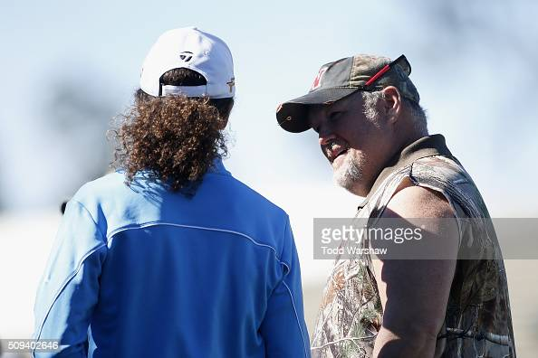 Comedian Daniel Lawrence Whitney also known as 'Larry the Cable Guy' talks to musician Kenny G after teeing off on the 1st hole during the 3M...