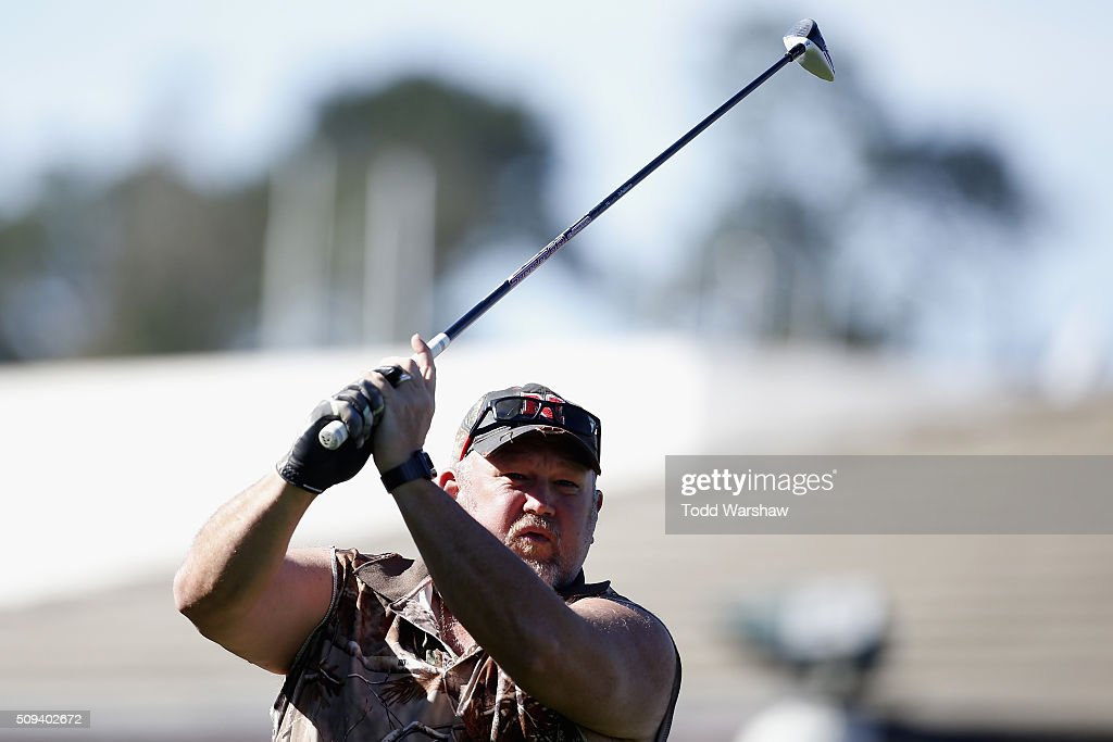 Comedian Daniel Lawrence Whitney (L), also known as 'Larry the Cable Guy', tees off on the 1st hole during the 3M Celebrity Challenge prior to the AT&T Pebble Beach National Pro-Am at Pebble Beach Golf Links on February 10, 2016 in Pebble Beach, California.