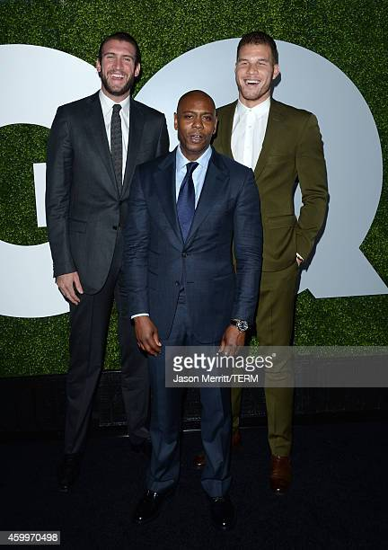 Comedian Dave Chappelle poses with professional basketball players Spencer Hawes and Blake Griffin at the 2014 GQ Men Of The Year party at Chateau...