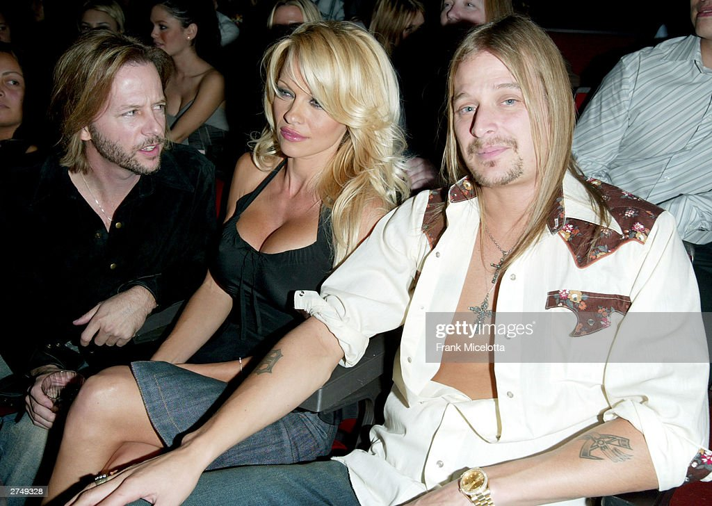Comedian <a gi-track='captionPersonalityLinkClicked' href=/galleries/search?phrase=David+Spade&family=editorial&specificpeople=209074 ng-click='$event.stopPropagation()'>David Spade</a>, actress <a gi-track='captionPersonalityLinkClicked' href=/galleries/search?phrase=Pamela+Anderson&family=editorial&specificpeople=171759 ng-click='$event.stopPropagation()'>Pamela Anderson</a> and musician <a gi-track='captionPersonalityLinkClicked' href=/galleries/search?phrase=Kid+Rock&family=editorial&specificpeople=171123 ng-click='$event.stopPropagation()'>Kid Rock</a> watch the show at VH1's Big In 2003 Awards on November 20, 2003 at Universal City in Los Angeles, California. VH1's Big in 2003 Awards will air in the U.S. on Sunday, November 30 at 9:00pm pst/et and will air in the U.K. on Friday, December 5 at 2100hrs.