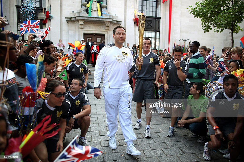 Comedian <a gi-track='captionPersonalityLinkClicked' href=/galleries/search?phrase=David+Walliams&family=editorial&specificpeople=203020 ng-click='$event.stopPropagation()'>David Walliams</a> sets off with the Olympic Torch from Islington Town Hall on day 69 of the London 2012 Olympic Torch Relay on July 26, 2012 in London, England. The Olympic Flame is now on day 69 of a 70-day relay, the penultimate leg of the flames journey before being taken to the Olympic Park on Friday for the opening ceremony.