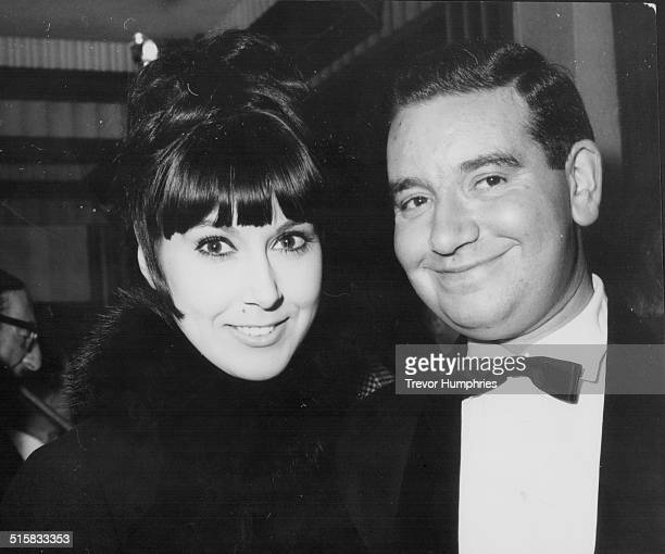 Comedian Dennis Goodwin and singer Anita Harris arriving at the London Pavilion for the premiere of the film 'Topkapi' London November 13th 1964