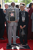 Comedian Dick Gregory and wife Lillian Gregory attend his being honored with a Star on the Hollywood Walk of Fame on February 2 2015 in Hollywood...