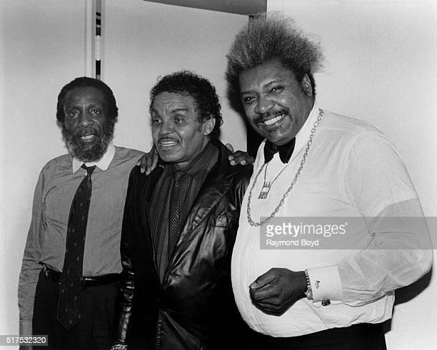 Comedian Dick Gregory Joe Jackson and boxing promoter Don King poses for photos during The Jacksons 'Victory Tour' preparty at the RitzCarlton Hotel...