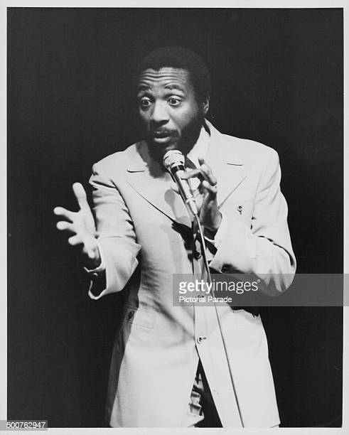 Comedian Dick Gregory performing on stage circa 19601970