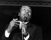 Comedian Dick Gregory performs onstage in circa 1961