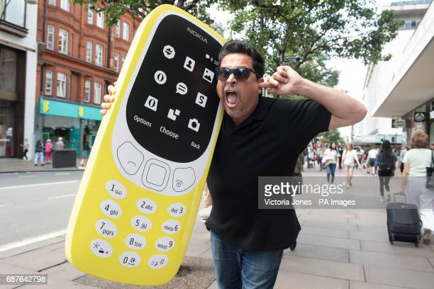 Comedian Dom Joly recreates a Trigger Happy TV moment to launch the new Nokia 3310 at Carphone Warehouse on Oxford Street London
