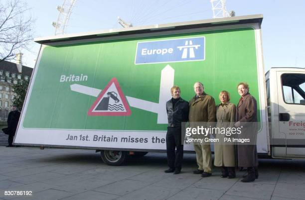 Comedian Eddie Izzard joins Conservative MP Ian Taylor Labour MEP Mary Honeyball and Liberal Democrats MP Susan Kramer in front of a poster depicting...