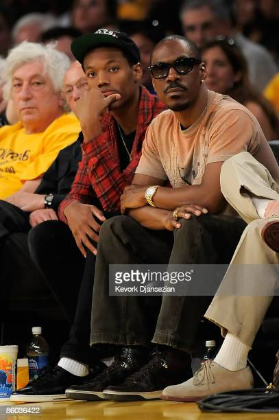 Comedian Eddie Murphy and son sit courtside during the Los Angeles Lakers and Utah Jazz Game One of the Western Conference Quarterfinals during the...