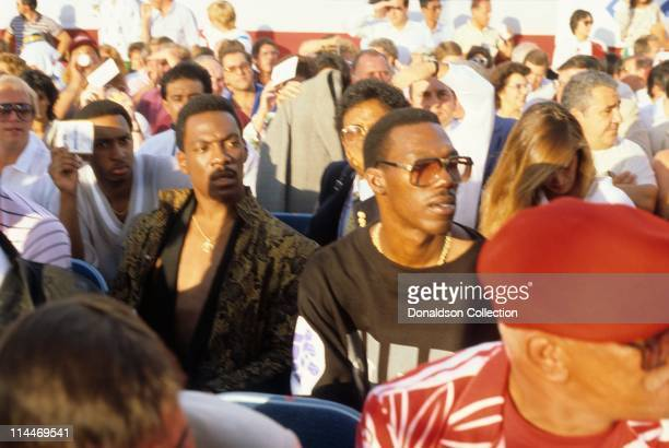 Comedian Eddie Murphy Charlie Murphy pose for a portrait in March 10 1986 in Los Angeles California