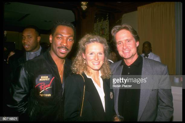 Comedian Eddie Murphy with actress Glenn Close and actor Michael Douglas