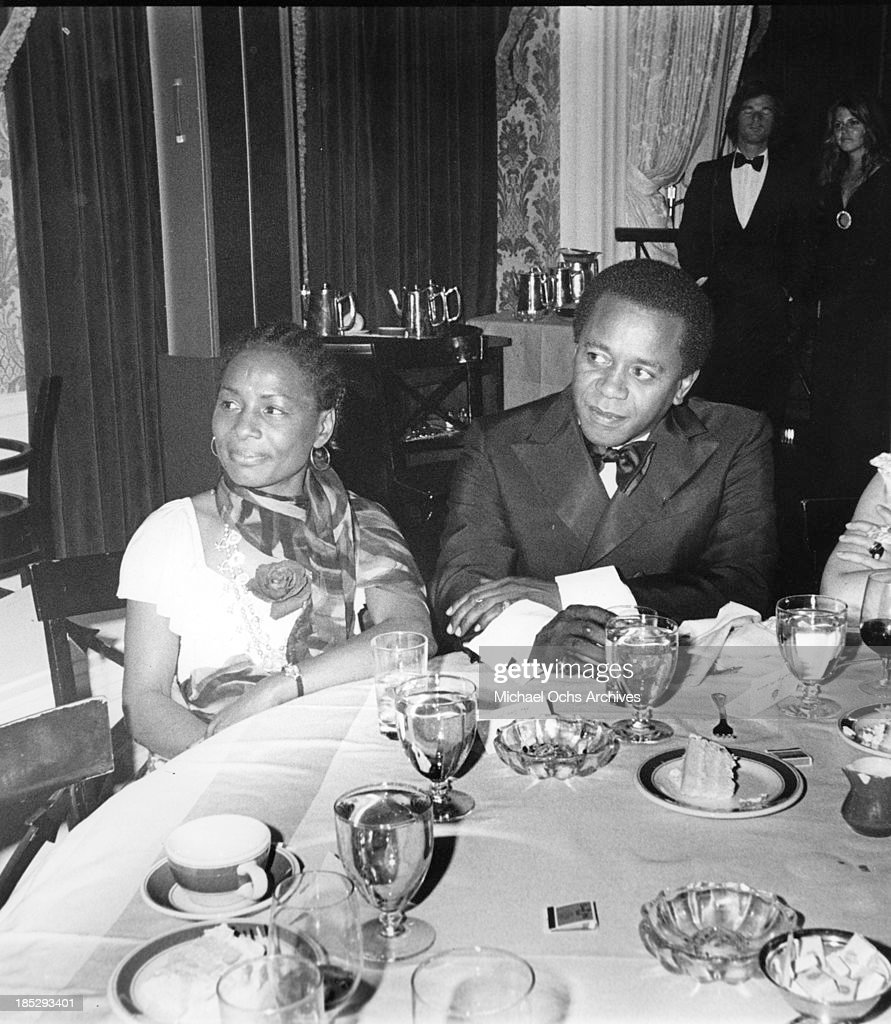 Comedian Flip Wilson attends an event with a woman at the Beverly Hills Hotel in circa 1976 in Los Angeles California