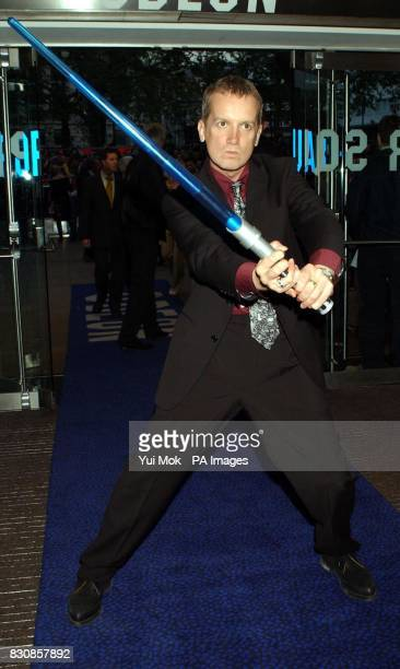 Comedian Frank Skinner arrives with a light sabre for the charity premiere of Star Wars Episode II Attack of the Clones at The Odeon Leicester Square...