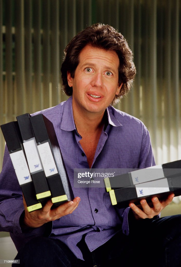 Comedian Gary Shandling poses with a stack of video tapes during a 1988 Los Angeles, California, photo portrait session. Shandling starred in the HBO TV series 'The Gary Shandling Show.'