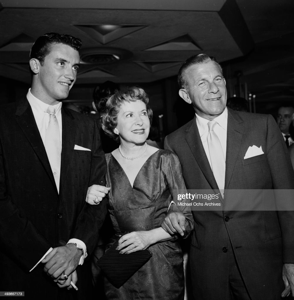 Comedian George Burns with wife Gracie Allen and son Ronnie Burns attend the Gisele MacKenzie party in Los Angeles California