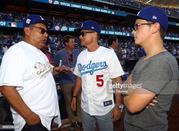 Comedian George Lopez and Actor Rob Lowe are seen on field before Game 1 of the 2017 World Series between the Houston Astros and the Los Angeles...