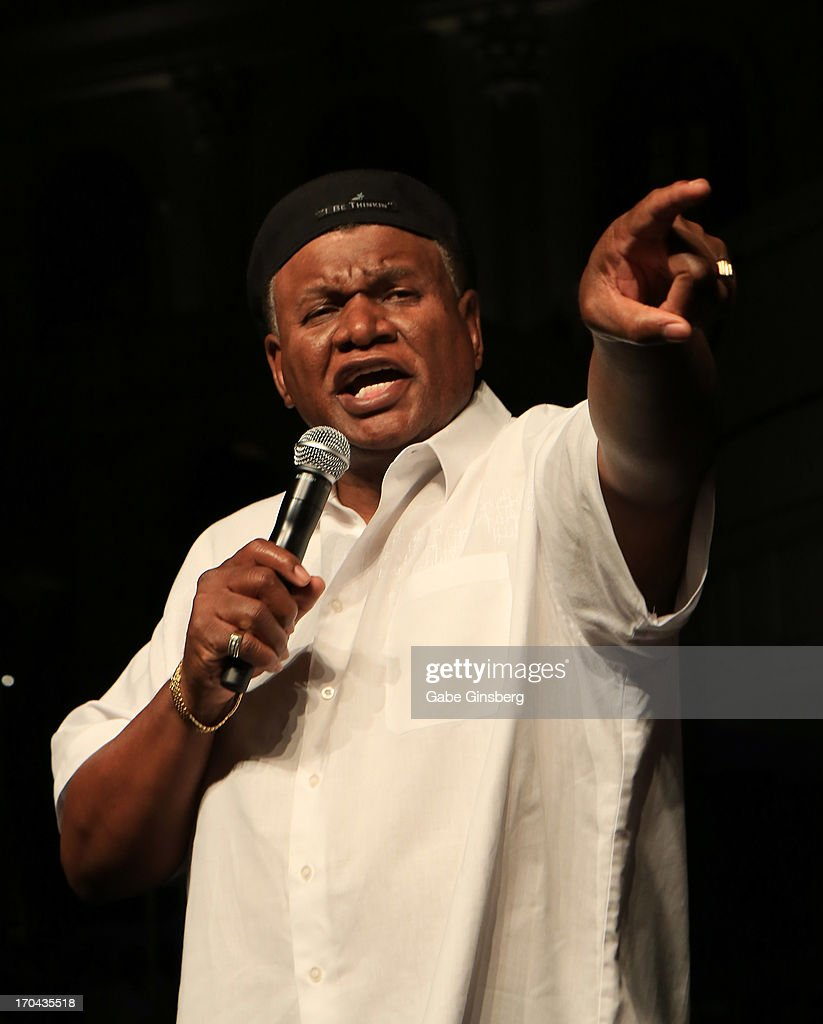 Comedian <a gi-track='captionPersonalityLinkClicked' href=/galleries/search?phrase=George+Wallace+-+Comedian&family=editorial&specificpeople=240706 ng-click='$event.stopPropagation()'>George Wallace</a> performs at the closing night party for the U.S. Travel Association's International Pow Wow at the Garden of the Gods Pool at Caesars Palace on June 12, 2013 in Las Vegas, Nevada.