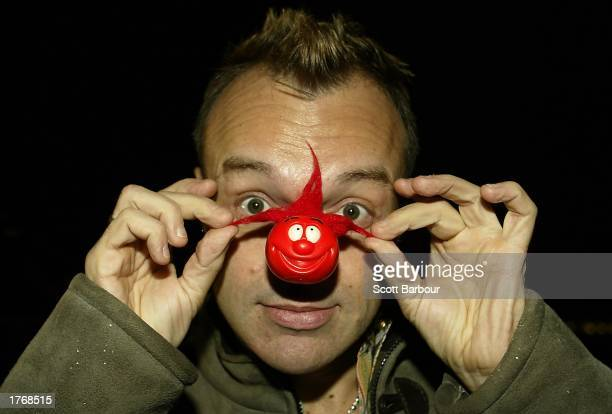 Comedian Graham Norton poses for photographers as he puts on a red nose at the official launch of the UK Comic Relief Red Nose Day February 7 2003 in...