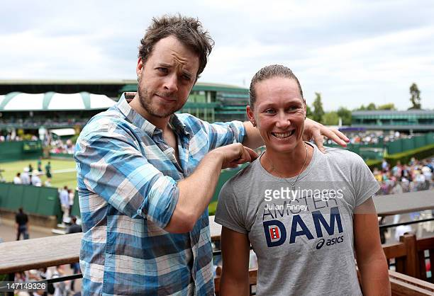 Comedian Hamish Blake poses for photographs with Samantha Stosur of Australia on day two of the Wimbledon Lawn Tennis Championships at the All...
