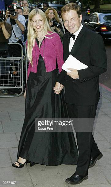 Comedian Harry Enfield and wife Lucy arrive at the Grosvenor House Art And Antiques Fair at The Grosvenor House Hotel on June 12 2003 in London