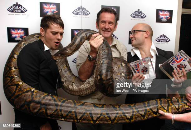 TV comedian Harry Hill winner of the Best Comedy Entertainment Personality Award with Matt Willis and a live 20 foot python handled by wildlife...