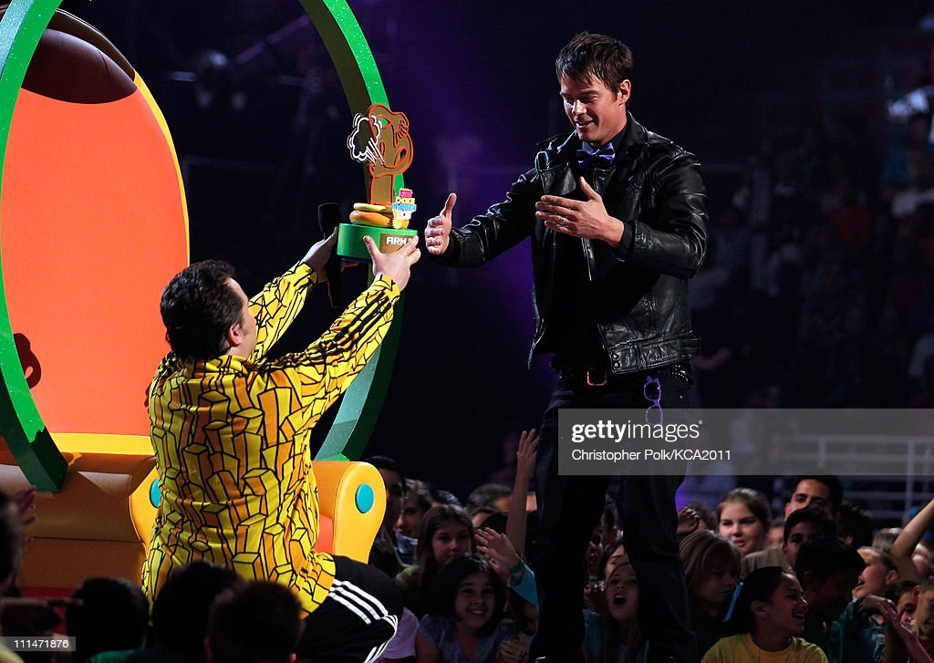 Comedian Jack Black presents actor Josh Duhamel with arm fart hall of famer award onstage during Nickelodeon's 24th Annual Kids' Choice Awards at...