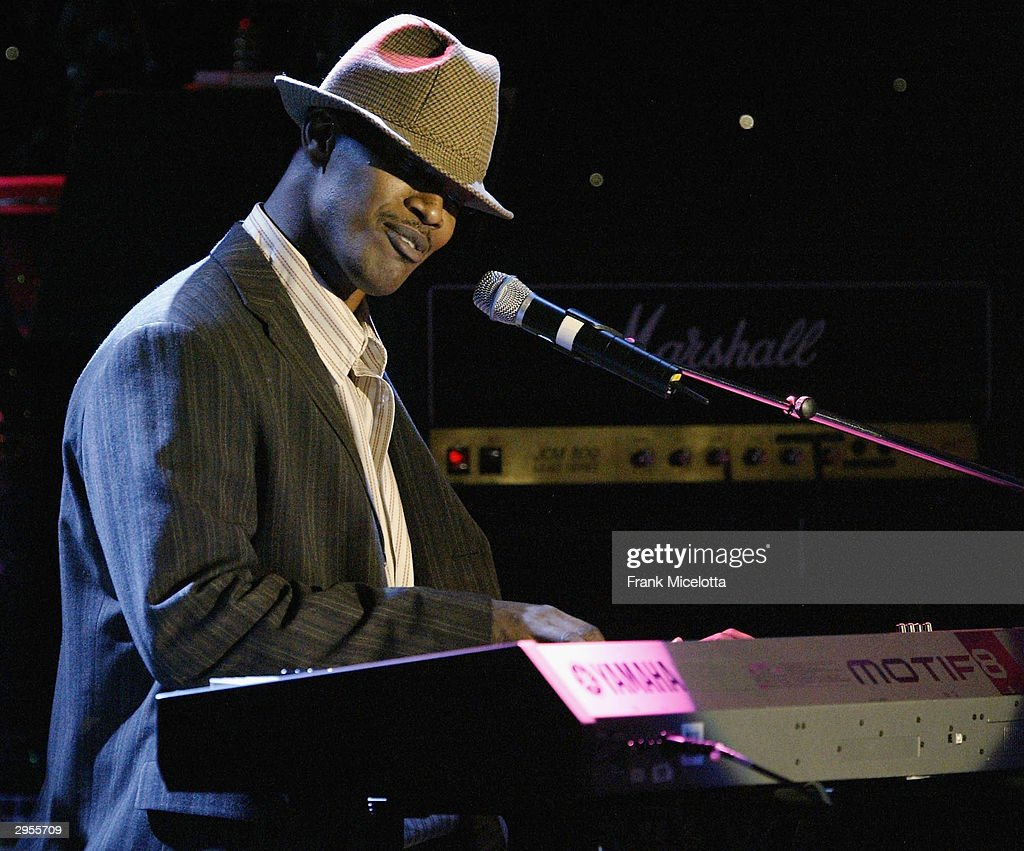 Comedian <a gi-track='captionPersonalityLinkClicked' href=/galleries/search?phrase=Jamie+Foxx&family=editorial&specificpeople=201715 ng-click='$event.stopPropagation()'>Jamie Foxx</a> performs at the legendary Clive Davis Pre-Grammy party at the Beverly Hills Hotel in Los Angeles, California, February 7, 2004.