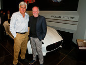 Comedian Jay Leno and Jaguar Design Director Ian Callum attend the Worlds Greatest Sports Coupe exhibit opening celebration with Jaguar at the...