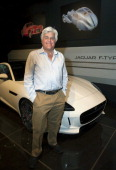 Comedian Jay Leno attends the Worlds Greatest Sports Coupe exhibit opening celebration with Jaguar at the Petersen Automotive Museum on April 9 2014...
