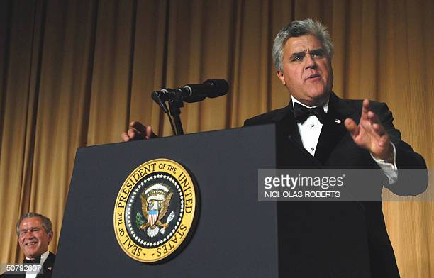 US comedian Jay Leno makes political jokes as US President George W Bush laughs at the White House Correspondents' Association dinner in Washington...