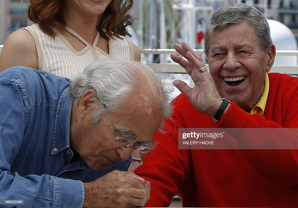 US comedian Jerry Lewis (R) and French composer Michel Legrand joke on May 23, 2013 while posing during a photocall for the film 'Max Rose' presented Out of Competition at the 66th edition of the Cannes Film Festival in Cannes. Cannes, one of the world's top film festivals, opened on May 15 and will climax on May 26 with awards selected by a jury headed this year by Hollywood legend Steven Spielberg.