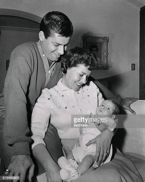 Comedian Jerry Lewis and his wife Patti pose with their baby son Scott Anthony for the infant's first photo in Hollywood April 12th The little boy...