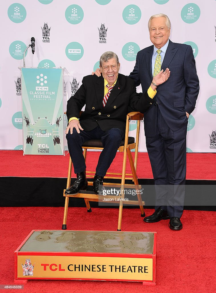 Comedian Jerry Lewis and Robert Osborne attend Lewis' Hand And Footprint Ceremony at TCL Chinese Theatre IMAX on April 12 2014 in Hollywood California