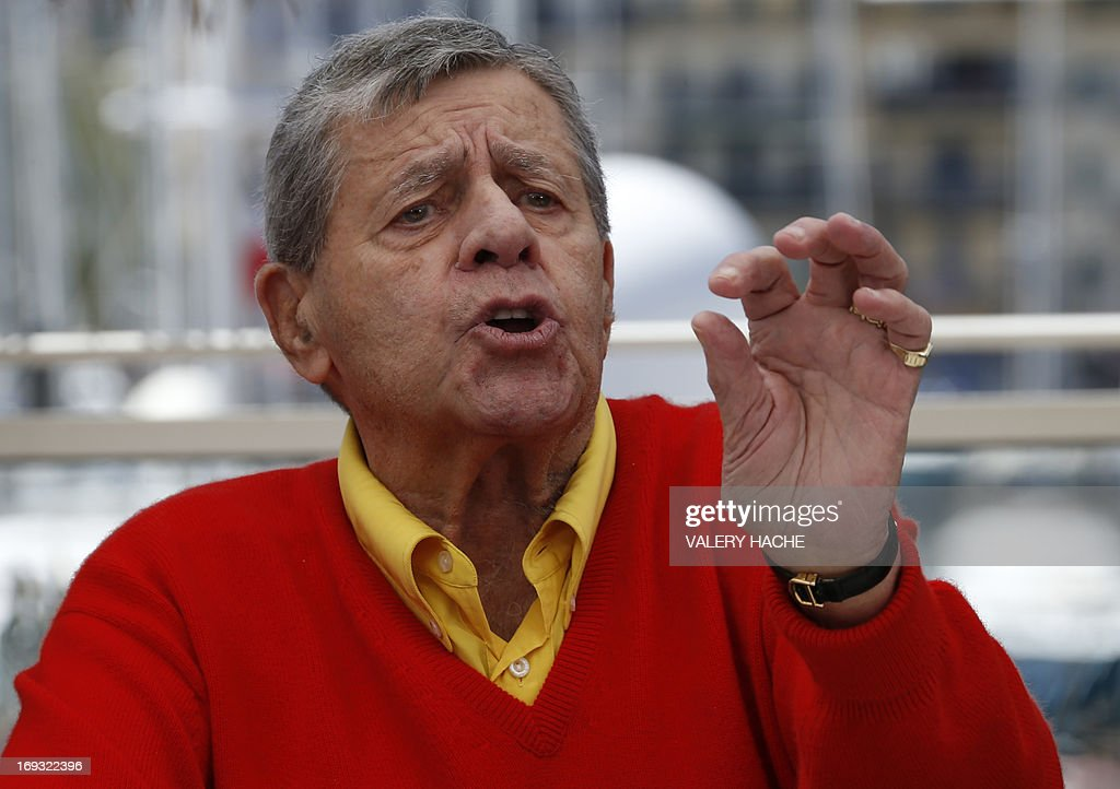 US comedian Jerry Lewis gestures on May 23, 2013 during a photocall for the film 'Max Rose' presented Out of Competition at the 66th edition of the Cannes Film Festival in Cannes. Cannes, one of the world's top film festivals, opened on May 15 and will climax on May 26 with awards selected by a jury headed this year by Hollywood legend Steven Spielberg.