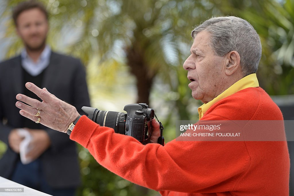 US comedian Jerry Lewis gestures on May 23, 2013 while holding a professional camera during a photocall for the film 'Max Rose' presented Out of Competition at the 66th edition of the Cannes Film Festival in Cannes. Cannes, one of the world's top film festivals, opened on May 15 and will climax on May 26 with awards selected by a jury headed this year by Hollywood legend Steven Spielberg.