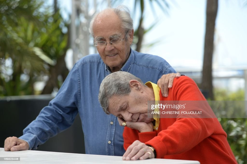 US comedian Jerry Lewis (R) jokes on May 23, 2013 with French composer Michel Legrand during a photocall for the film 'Max Rose' presented Out of Competition at the 66th edition of the Cannes Film Festival in Cannes. Cannes, one of the world's top film festivals, opened on May 15 and will climax on May 26 with awards selected by a jury headed this year by Hollywood legend Steven Spielberg.