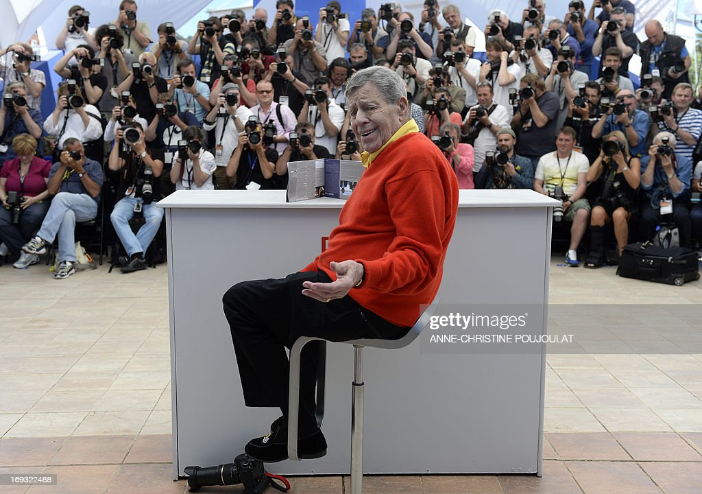 US comedian Jerry Lewis poses on May 23, 2013 during a photocall for the film 'Max Rose' presented Out of Competition at the 66th edition of the Cannes Film Festival in Cannes. Cannes, one of the world's top film festivals, opened on May 15 and will climax on May 26 with awards selected by a jury headed this year by Hollywood legend Steven Spielberg. AFP PHOTO / ANNE-CHRISTINE POUJOULAT